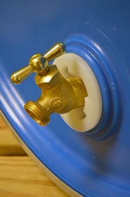 rain barrel bung spigot for use in a recycled plastic barrel